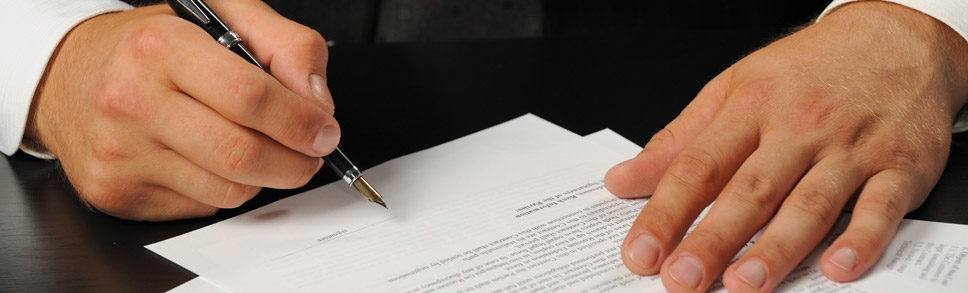 Picture of person signing document